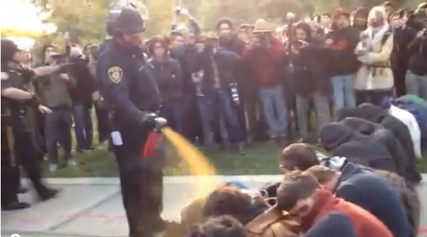 Policeman casually pepper spraying students at UC Davis